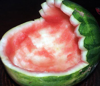 Hollow out the watermelon with a spoon or melon baller and put some of ...